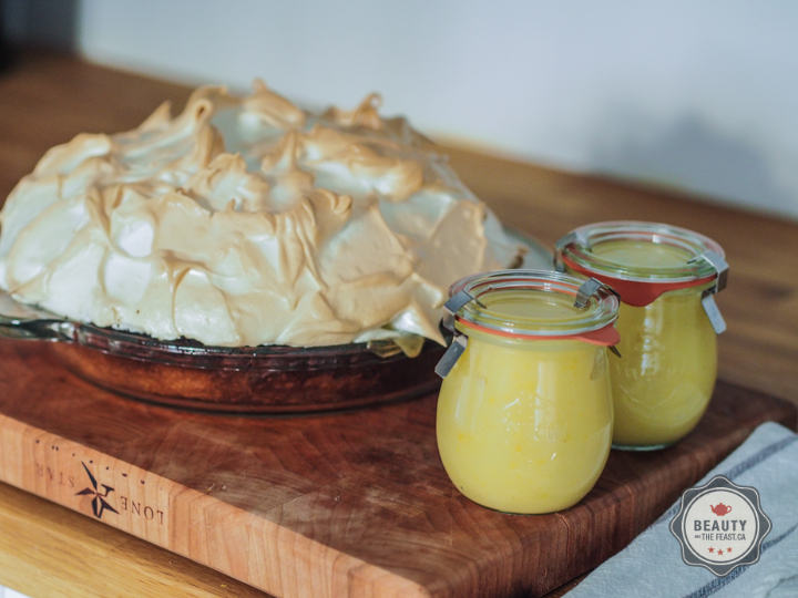 Lemon Meringue Pie with jars of left over lemon curd