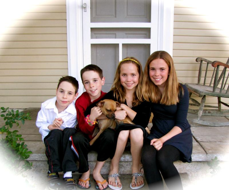 Manning's 4 children - Aidan, Tristan, Caroline, and Natalie - with dog, Lulu