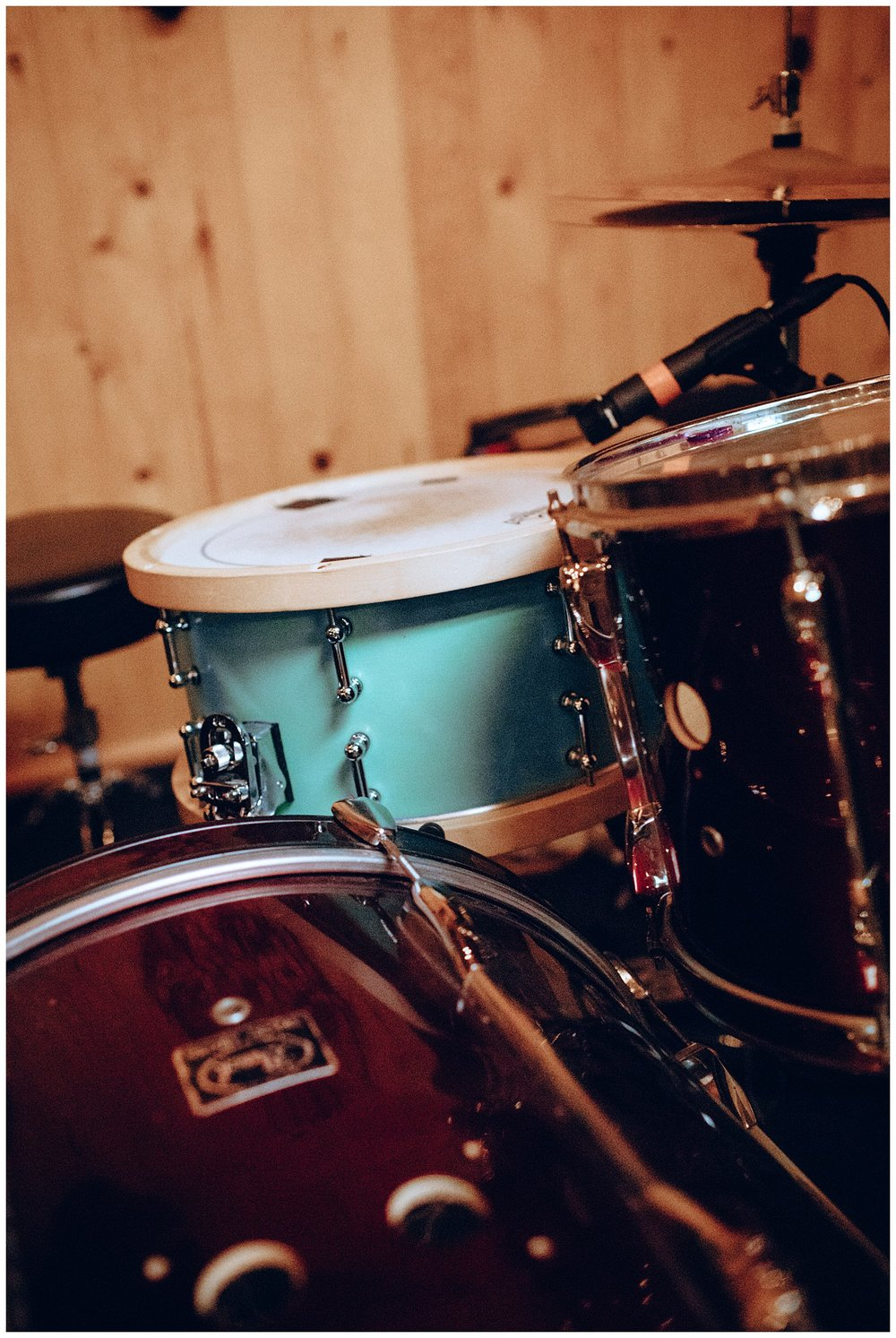 Chamonix Films - Seattle Music Videographer - Music Photography - drumset teal red