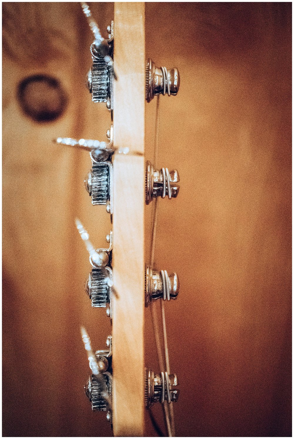 Chamonix Films - Seattle Music Videographer - Music Photography - abstract instrument photos guitar tuning pegs
