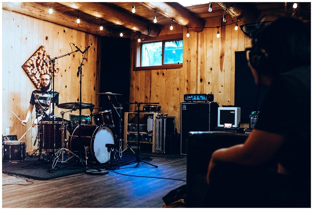 Chamonix Films - Seattle Music Videographer - Music Photography - cabin recording studio drumset