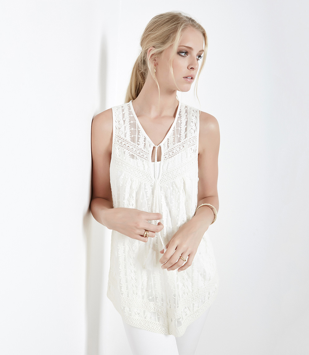 Embroidered Lace Tank - Karen Kane embroidered lace tank Another trend-worthy piece is this Karen Kane embroidered lace tank in off-white. We love this one particularly because of its delicate design. A great thing about this top is that it is sheer, so you can pair it with any color to complete a completely new look.