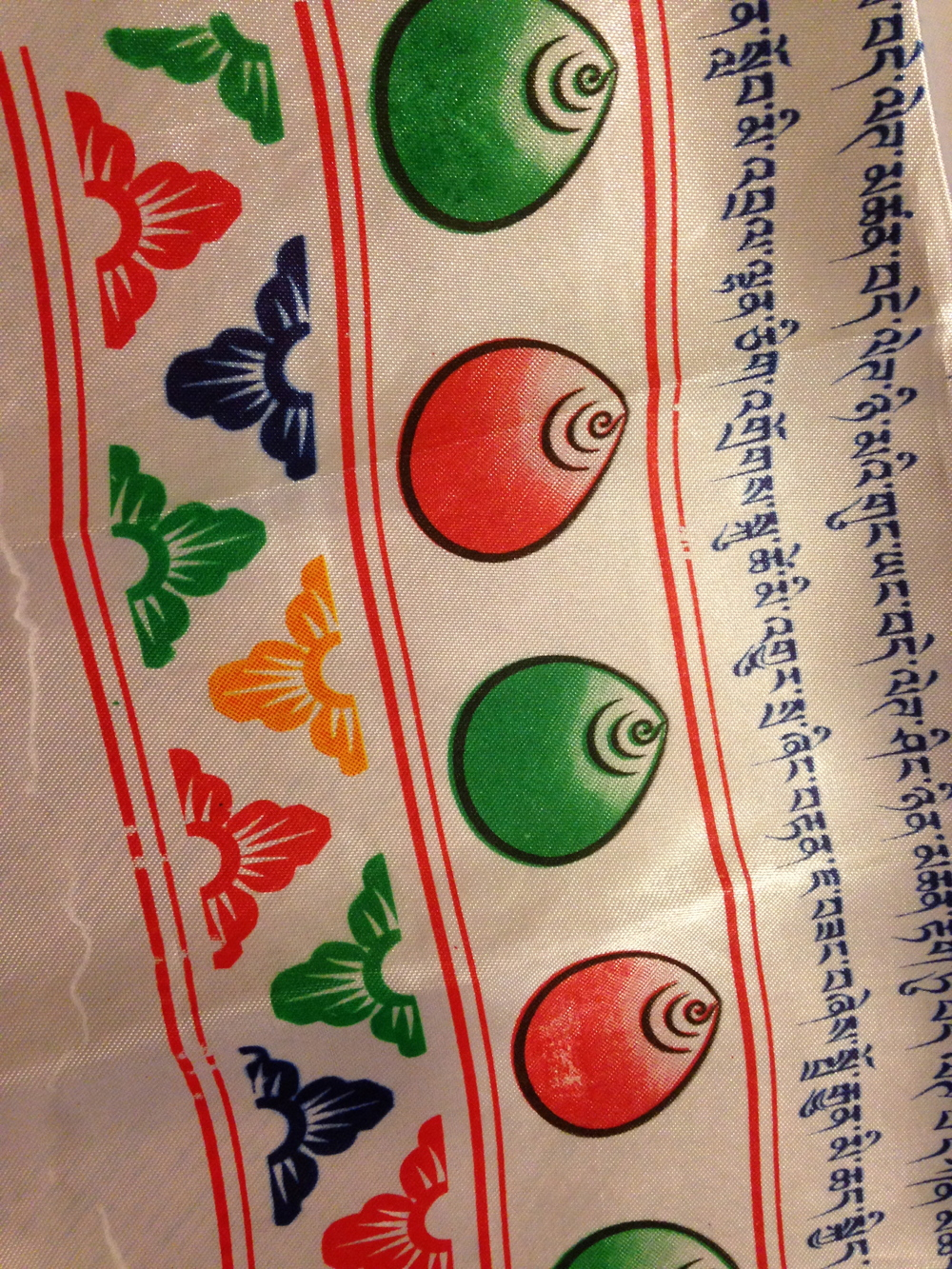 A silk khata scarf with Tibetan mantras.