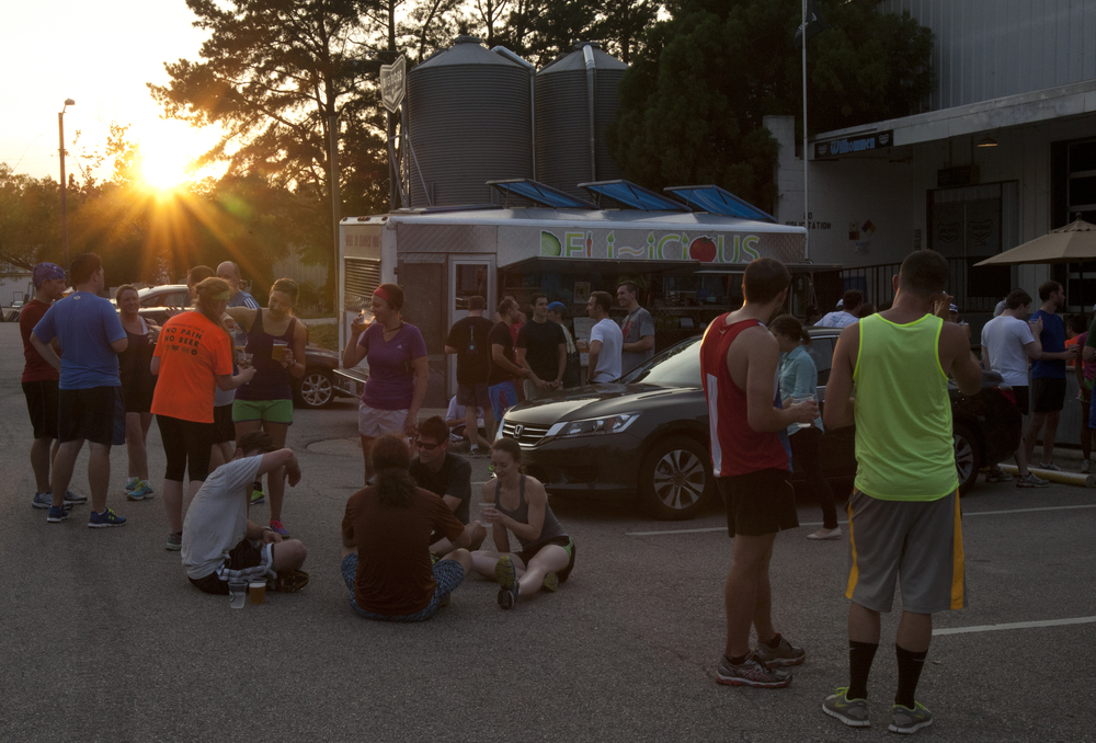 Tuesday: Runners from the Big Boss Run Club gather outside of Big Boss Brewery enjoying food from Deli-icious, a local food truck. It was a tough week for food truck employees who work inside the small trucks without air conditioning.
