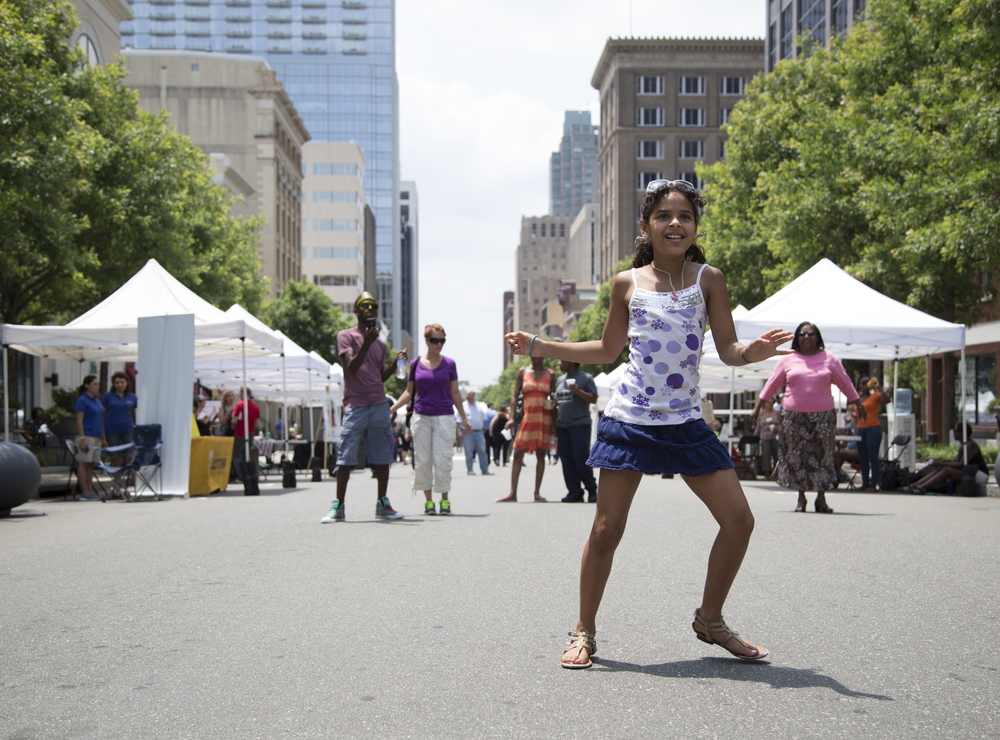 Jasmin Horton, 10, dances at the World Refugee Day Festival in downtown Raleigh on Friday. At the event, people could sample food, music and dancing from nations such as Ethiopia, Afghanistan, Somalia, Iraq, Eritrea and Congo.