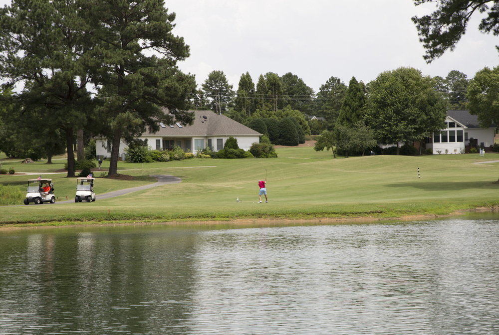 Thursday: I went back to Fuquay-Varina to take photos of a golf course that is closing. The manager gave me a golf cart and told me to do what I needed. Unfortunately it wasn't a very popular day to golf.