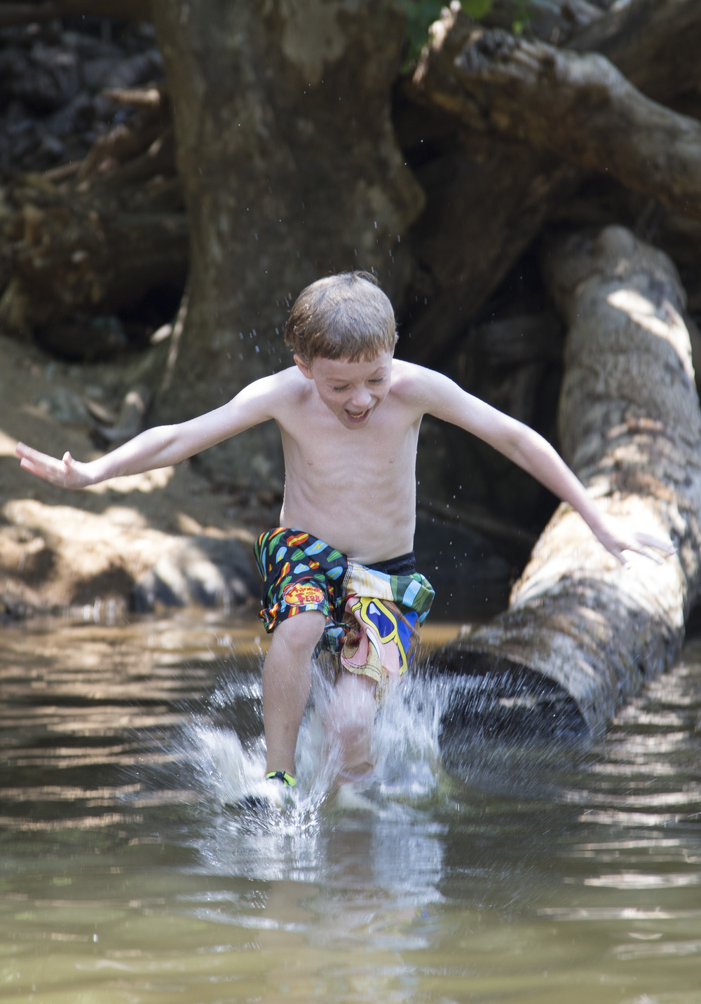 Zane Cornwright, 7, of Durham, jumps into the Eno River in Durham during the Festival for the Eno on Friday, July 4, 2014.