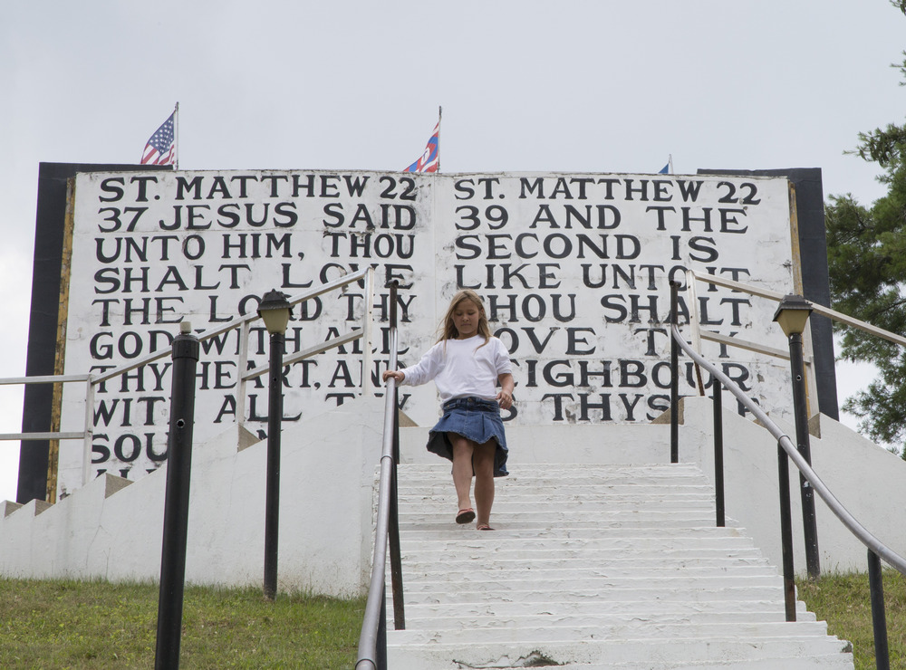 Monday: I traveled to Murphy, N.C. to see the world's largest Ten Commandments at the Fields of the Wood Bible park.  Evelyne Williams, 9, climbs down the steps running alongside the world's largest depiction of the Ten Commandments at Fields of the Wood Bible Park in Murphy, N.C., Monday, July 7, 2014.