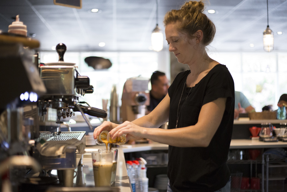 Tuesday: Jennifer Hall makes a drink at Sola Coffee Cafe in Raleigh on Tuesday, June 15, 2014. Sola Coffee Cafe is a member of the Greater Raleigh Merchants Alliance and its Shop Local Raleigh campaign, which promotes and supports locally-owned, independent businesses.