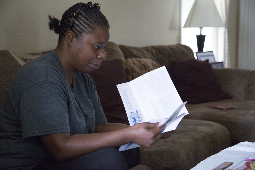 Monica Alexander reviews her son McKinley Patterson's end-of-grade test results in her home in Zebulon, N.C., on Wednesday, July 23, 2014.