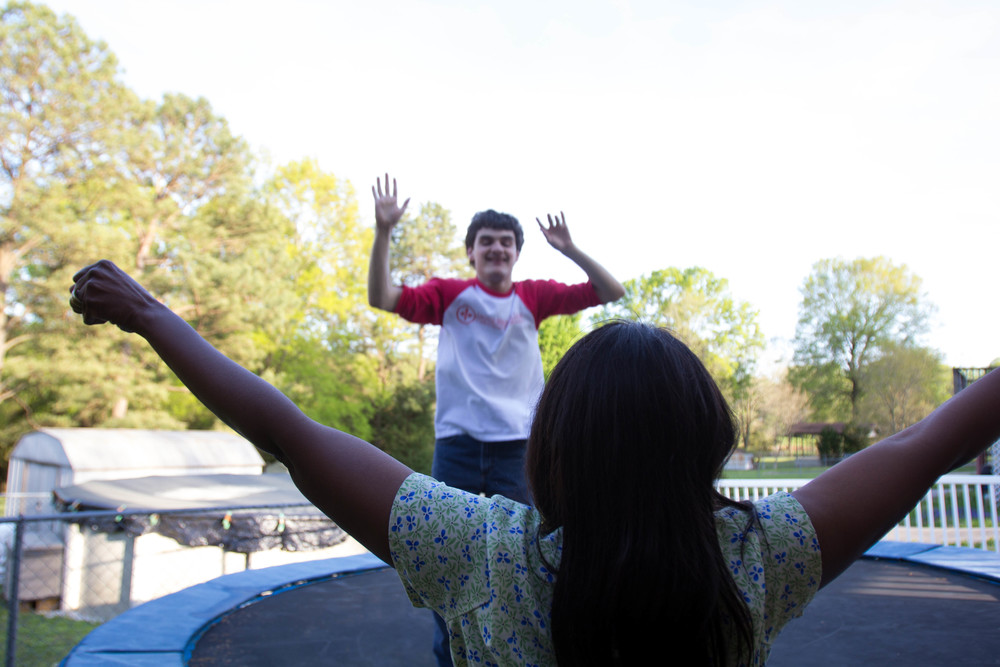 Zack has always been an active child. When he was younger, he would jump for hours and hours on a small trampoline in his bedroom. As he grew taller and outgrew the indoor trampoline, Vicki and Kevin bought a larger outdoor trampoline.  Here, one of his therapists, Michelle, cheers him on as he jumps.