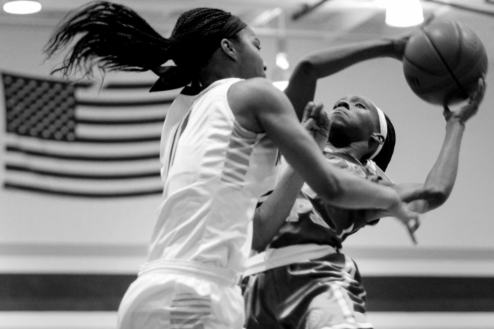 Junior point guard Kaila Ealey (14) has proved to be a vital part of the Lady Cap's success. Despite efforts, the Hillside Hornets quickly ran up the score.