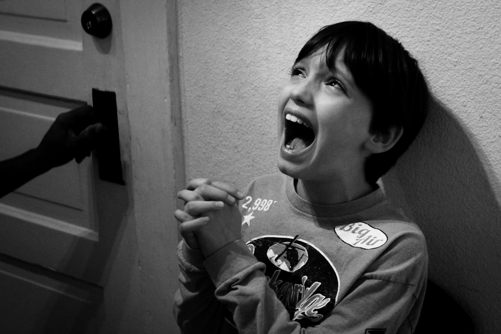 Gavin Benner, 9, screams during a meltdown at his school in Durham, N.C., on November 21, 2013. Gavin has autism, a developmental disorder that affects the neurological development of social and communication skills. When Gavin gets frustrated and struggles to communicate, he screams. Usually the screams will subside after a minute, but these screams lasted over 10 minutes. The teachers removed him from the classroom and waited until he calmed down.