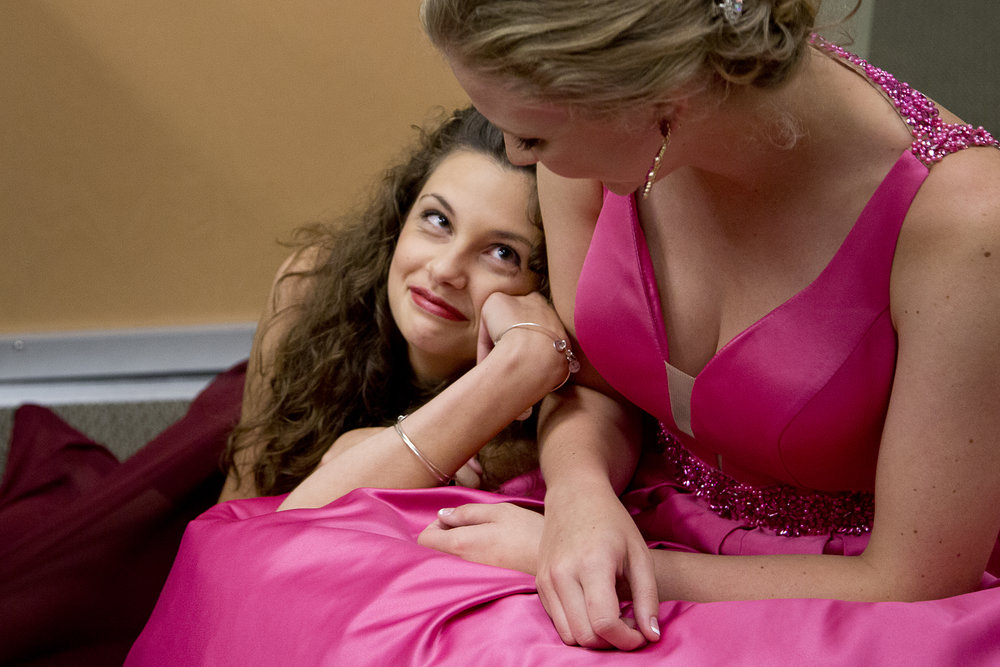 2015 first runner-up Kelsey Graman, 19, comforted contestant Haley Sample of Jasper, 18, while waiting backstage for the formal round of the Miss Strassenfest pageant at Redemption Christian Church in Jasper on Saturday.