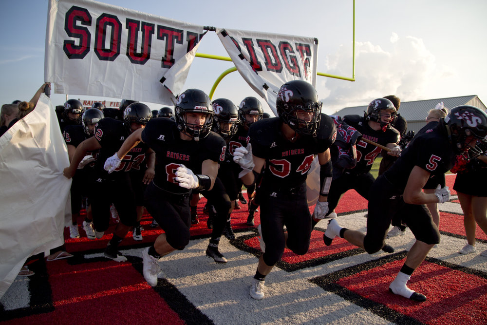 The Southridge Raiders ran onto the field before the start of their season opener against Corydon Central at Southridge High School in Huntingburg on Friday. The Raiders beat the Panthers 21-14.