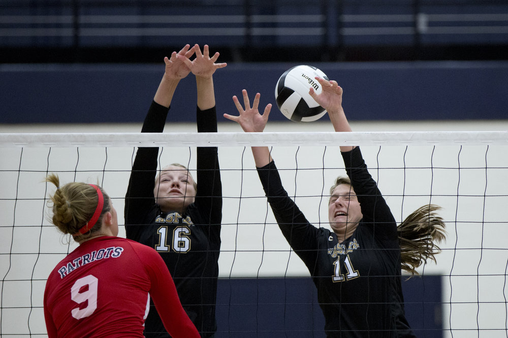 Jasper's Riley Merder and Jocelynn Morrow struggled to defend after Heritage Hills' Sydney Scherry spiked the ball over the net during the game at Heritage Hills High School in Lincoln City on Tuesday. The Patriots beat the Wildcats three sets to none.