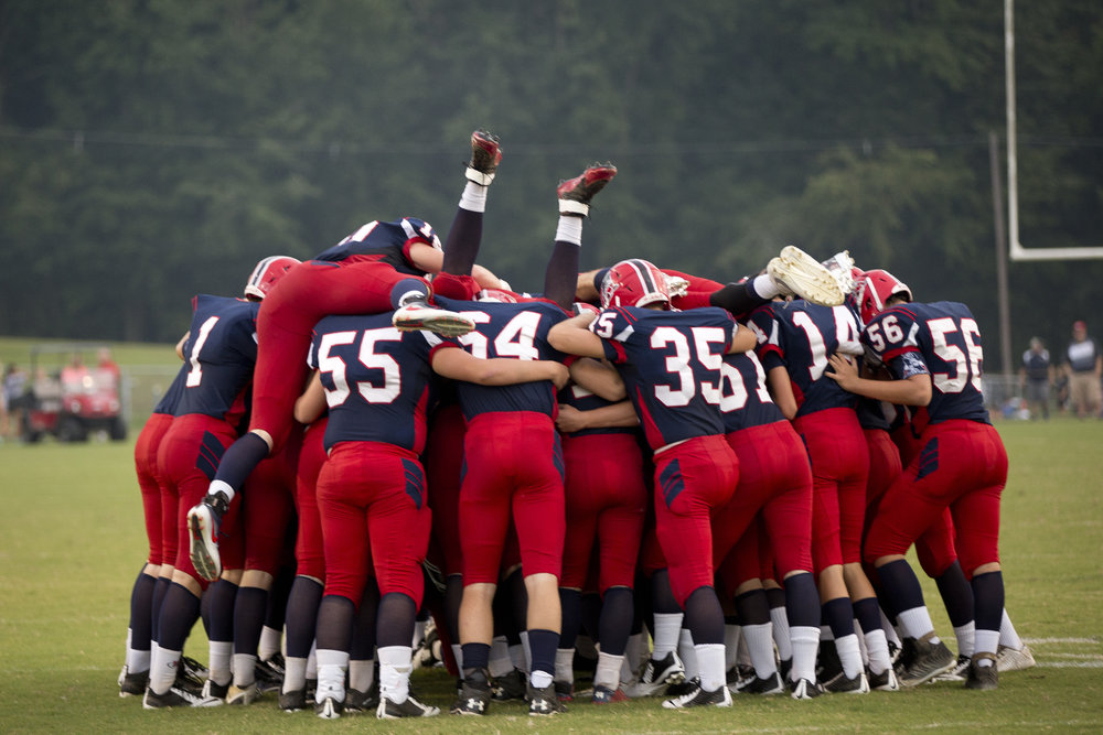 The Heritage Hills Patriots dove into a huddle before the start of the game against Tell City in Lincoln City on Friday. The Patriots beat the Marksmen 20-3.