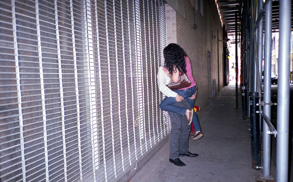 woman in mans arms in alley.jpg