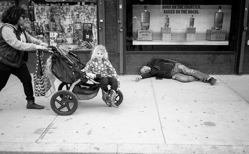 kid in stroller and passed out man.jpg