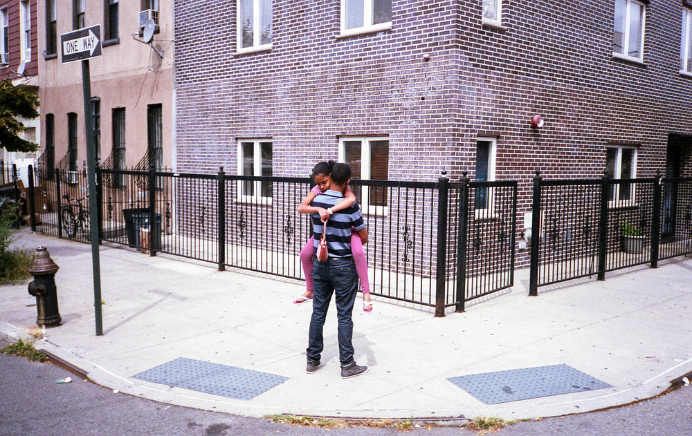 girl in dads arms on corner.jpg