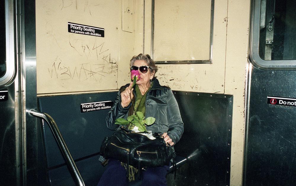 woman smelling rose on train 1.jpg