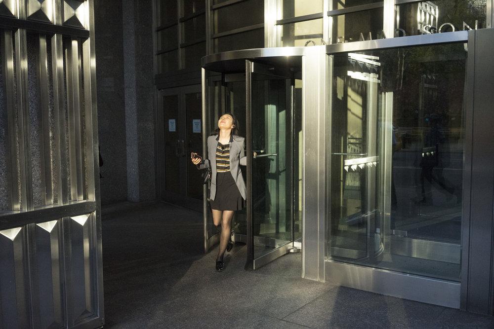 asain woman revolving doors.jpg