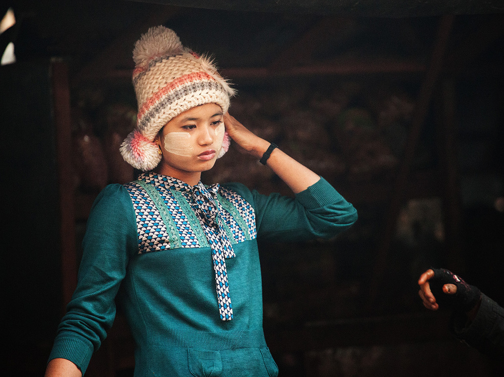 The majority of Burmese women wear the yellow thanaka bark patterns on their cheeks