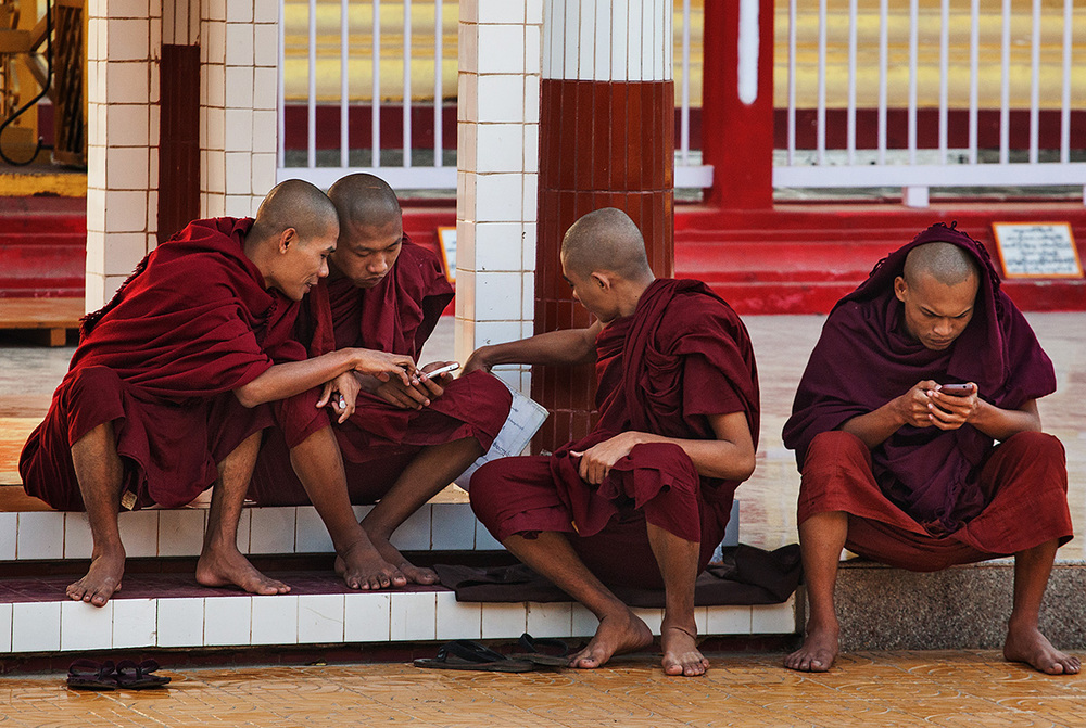 Monks doing other stuff than praying and looking pious