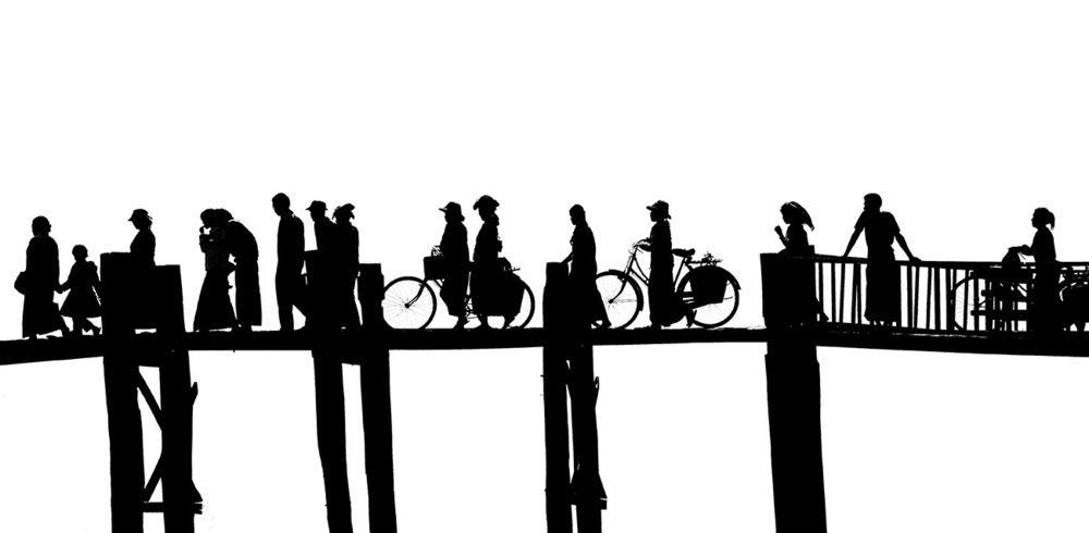 I love the silhouttes of the different people crossing the bridge