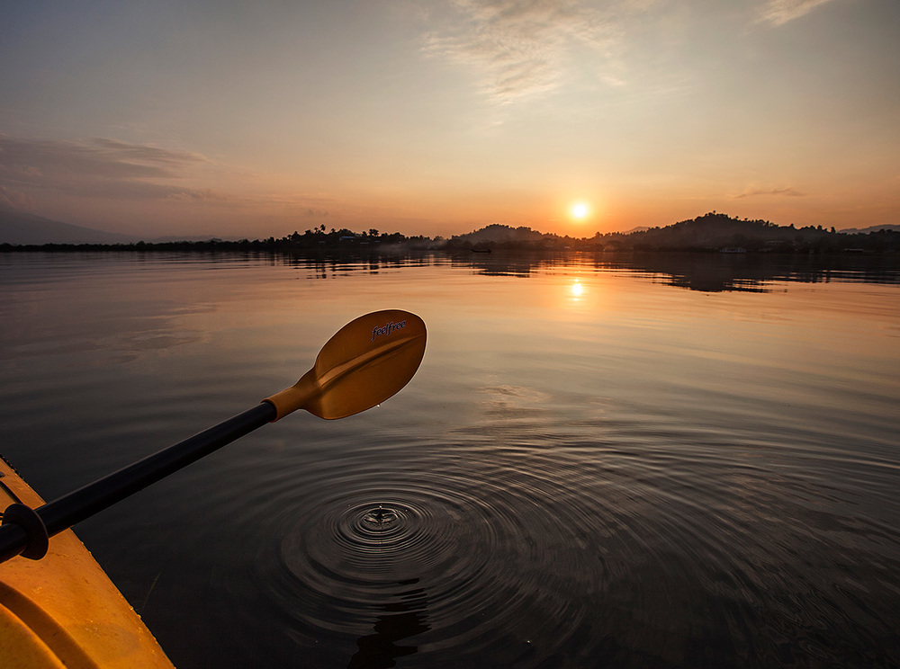 Taking a kayak on the lake for sunset