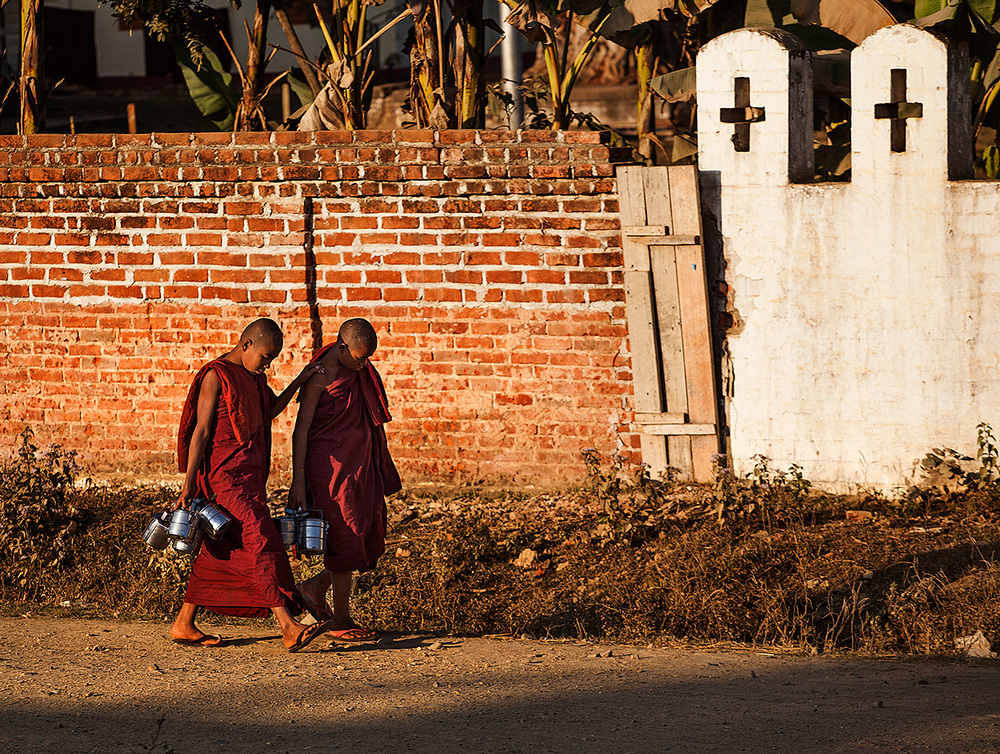 Monks walk by in the primarily Catholic Kachin State