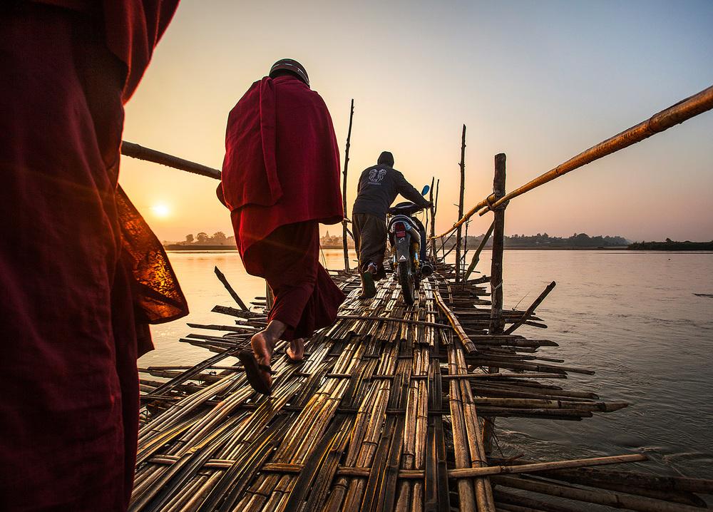 monks cross at sunrise