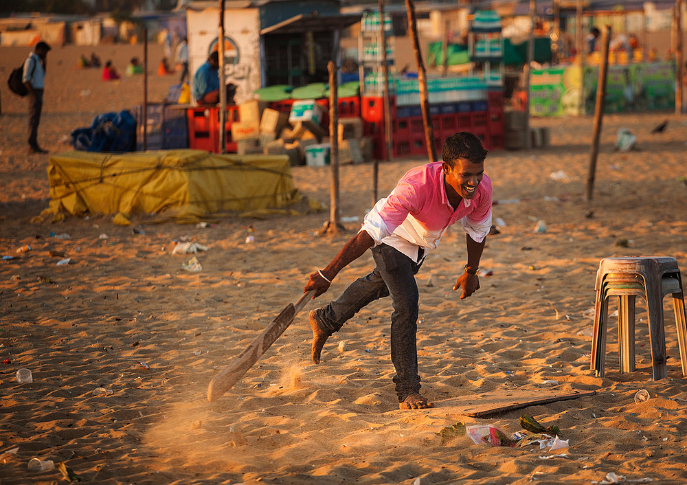 cricket on the beach. Not the cleanest place.
