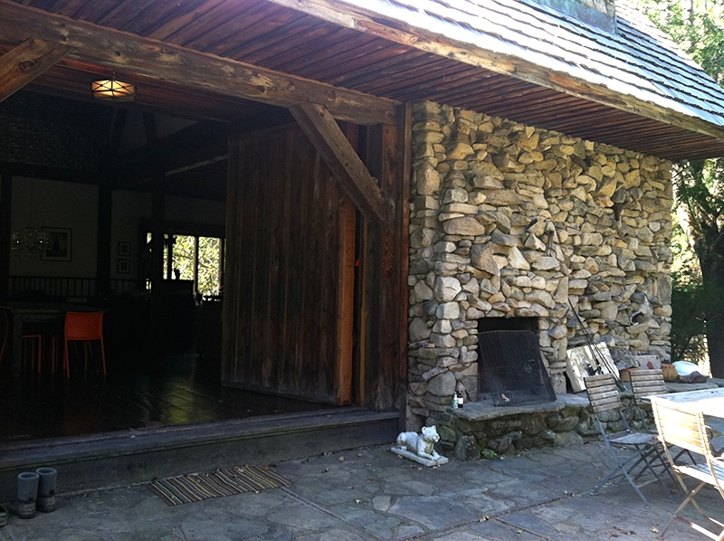 Barn doors open to the bluestone patio