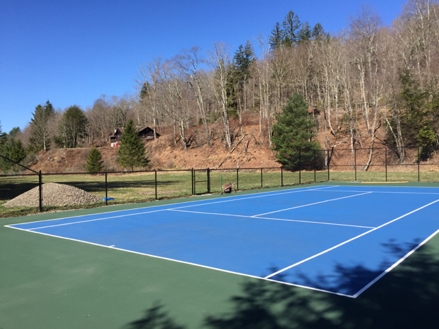Tennis court with the house in the distance.