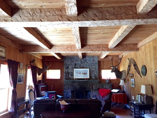 And dramatic coffered ceiling, ornamented with chunky hand-hewn beams.