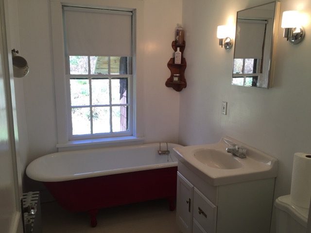 One of two more full guest bathrooms.