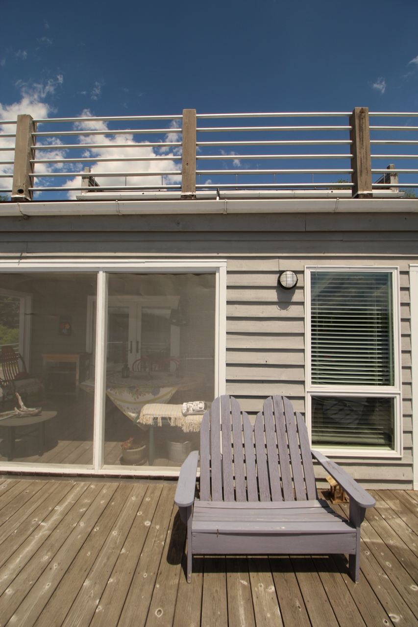 Second level deck off sunroom and off screened porch.
