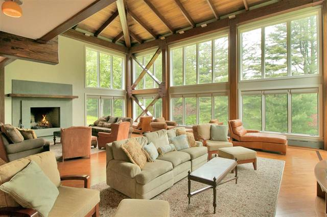 The twenty-eight foot floor to ceiling windows overlook 3.75 secluded acres with serene views of pond and lake.