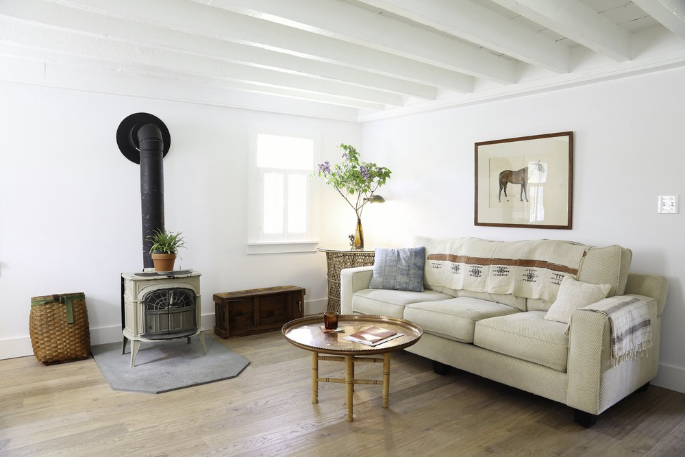 LIVING ROOM INTERIOR WOOD STOVE COUCH 2_ESCAPE BROOKLYN.jpg