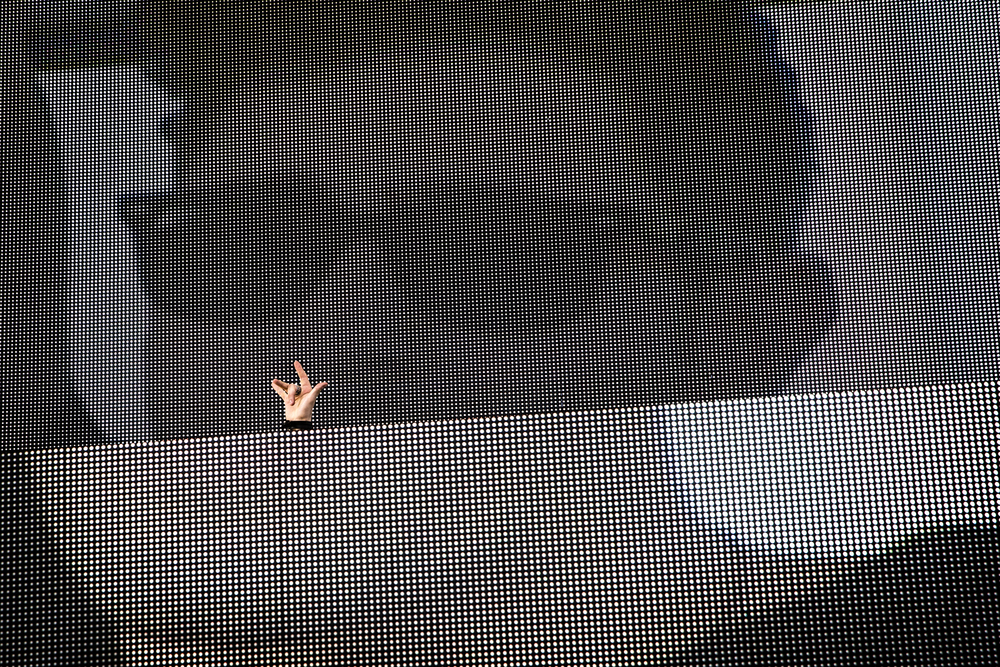 3LAU raises his hand in the air. He was one of two DJs that performed at Syracuse University's tenth annual Juice Jam.
