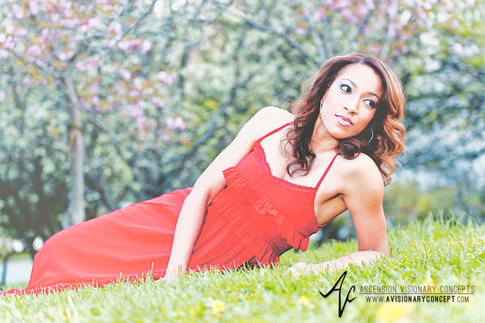 Buffalo Fashion Photography Buffalo Portrait Photography Spring Shoot Buffalo HIstory Museum 007 Flowy Red Dress Cherry Blossoms African American Model.jpg