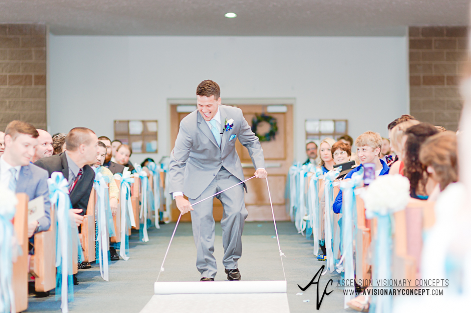 Rochester Wedding Photography Plantation Party House Spencerport Wedding 015 - Ceremony groom roll out white runner.jpg