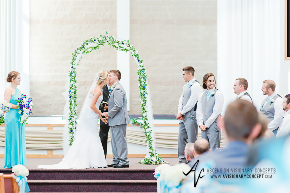 Rochester Wedding Photography Plantation Party House Spencerport Wedding 020 - Ceremony first kiss.jpg