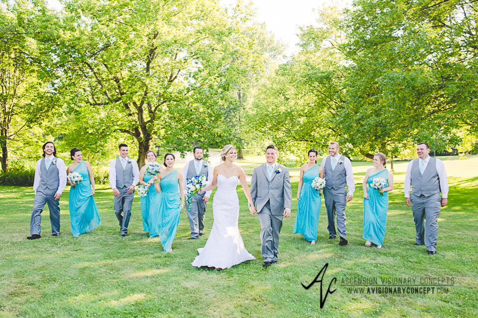 Rochester Wedding Photography Plantation Party House Spencerport Wedding 033 - Bridal Party Walking Laughing Turquoise Bridesmaids Dresses Grey Suits.jpg