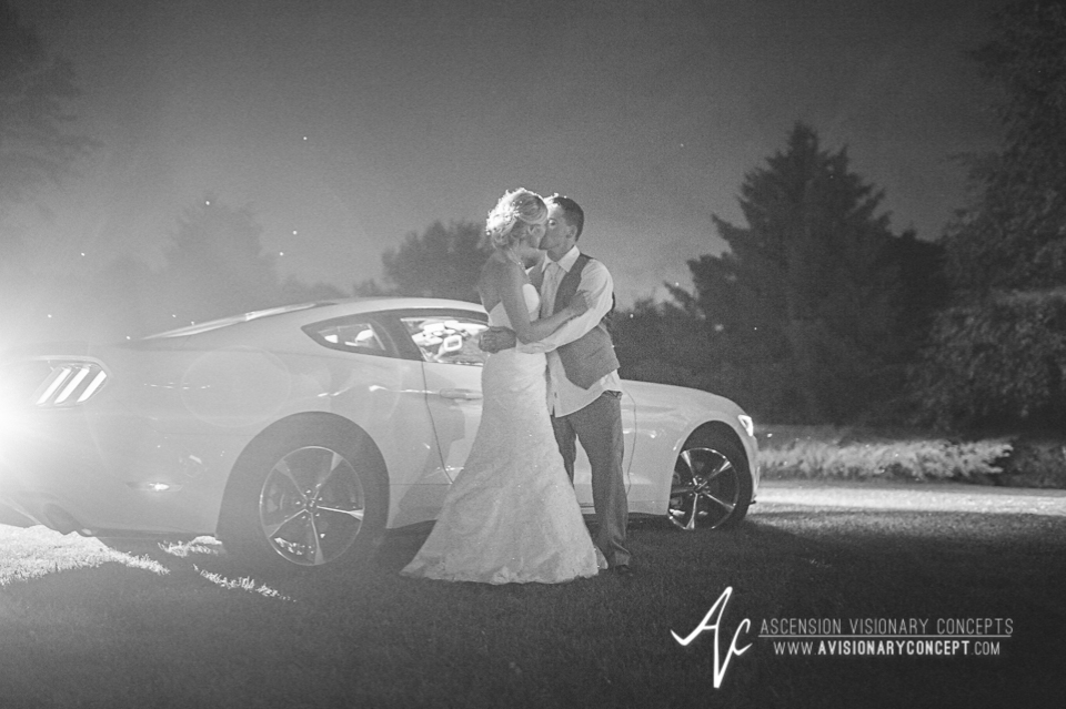 Rochester Wedding Photography Plantation Party House Spencerport Wedding 067 - Bride Groom Sports Car Black and White Night Shot.jpg