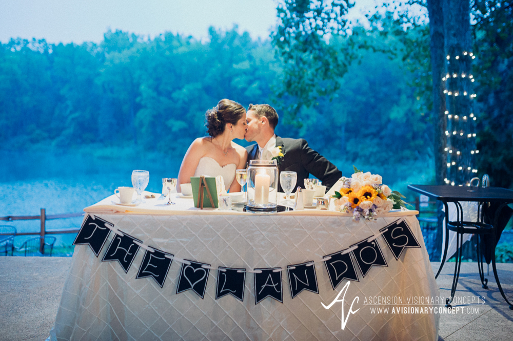 Buffalo Wedding Photography Spring Lake Winery 077 - Wedding Reception Bride Groom Sweetheart Table Kiss.jpg