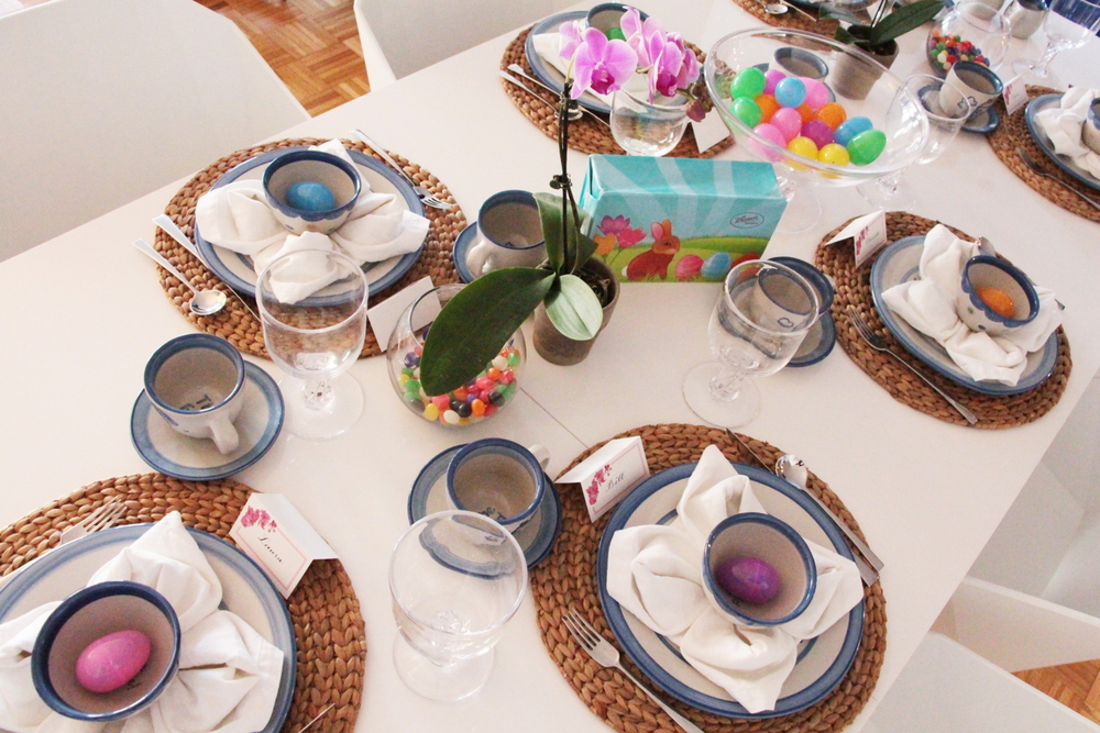 LAURA ANN Orchid Collection place cards alongside fresh orchids set the Easter table theme. Easter eggs and jelly beans added an extra pop of color.
