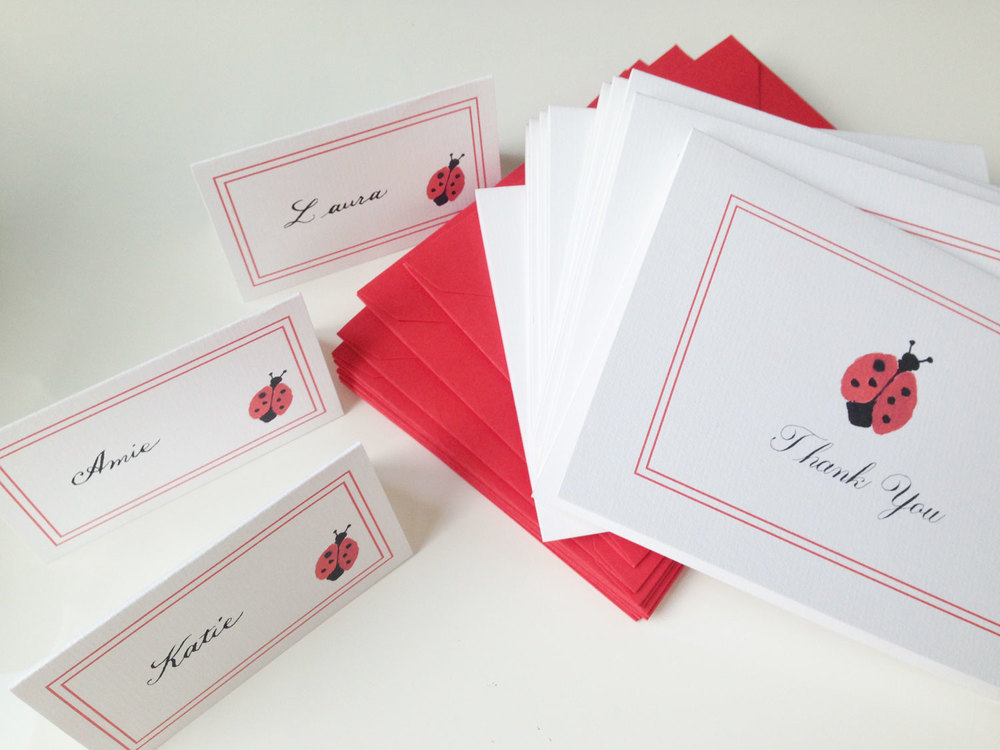 Ladybug place cards and thank you notes for a dinner to welcome a lucky little lady.