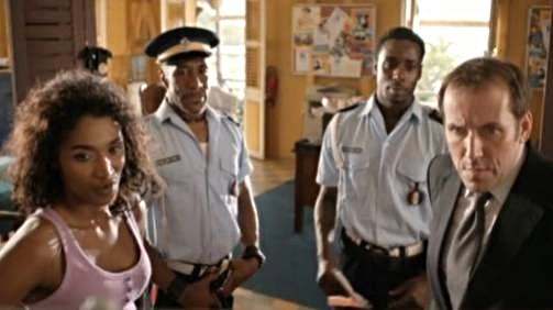 "Death in Paradise -  The original team : Left-to-right: Sara Martins, Danny John-Jules, Gary Carr and Ben Miller -   ""Death in Paradise cast photo"" by Source. Licensed under Fair use via Wikipedia -"